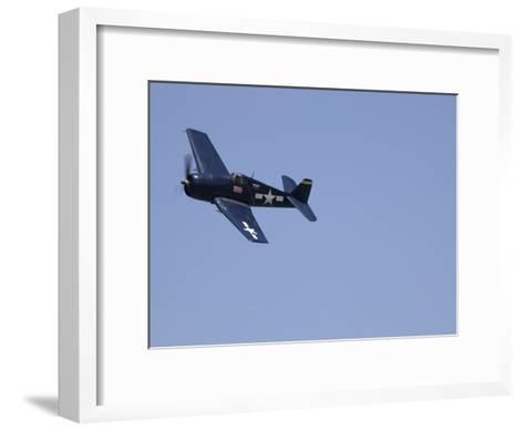 A Blue Grumman F6F-5 Hellcat Fighter Aircraft Flies Solo-Pete Ryan-Framed Art Print