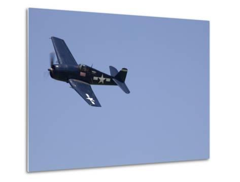 A Blue Grumman F6F-5 Hellcat Fighter Aircraft Flies Solo-Pete Ryan-Metal Print