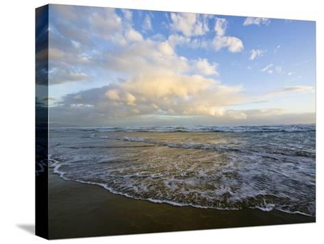 Storm Clouds Reflect Pastel Colors in Waves Rolling into Shore-Jason Edwards-Stretched Canvas Print