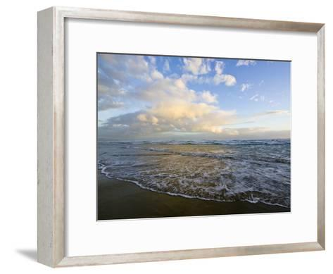 Storm Clouds Reflect Pastel Colors in Waves Rolling into Shore-Jason Edwards-Framed Art Print
