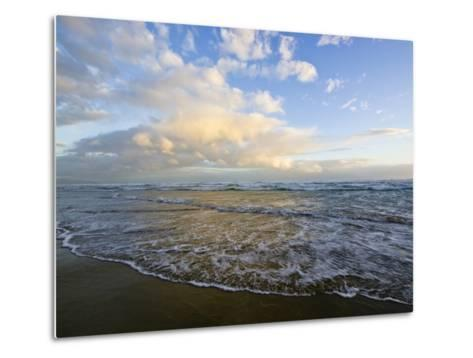 Storm Clouds Reflect Pastel Colors in Waves Rolling into Shore-Jason Edwards-Metal Print