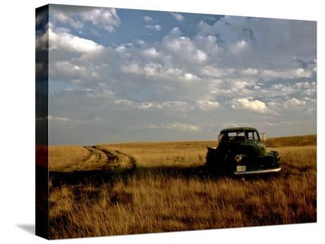 A Landscape of an Old Farm Truck in a Field at Sunset-Kenneth Ginn-Stretched Canvas Print