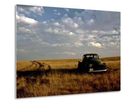 A Landscape of an Old Farm Truck in a Field at Sunset-Kenneth Ginn-Metal Print