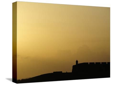 Morro Fortress Silhouetted Against a Sunset Sky-Raul Touzon-Stretched Canvas Print