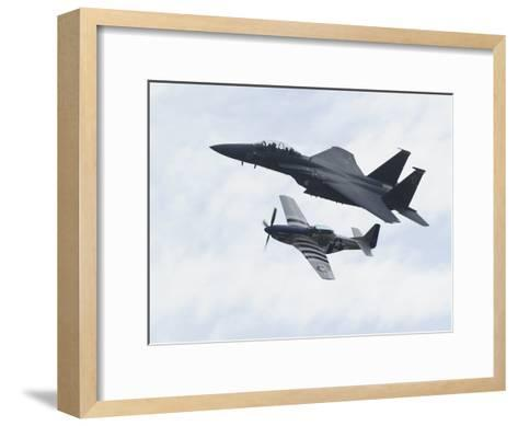 An F-15 Eagle and the P-51 Mustang Fly in Formation-Raul Touzon-Framed Art Print