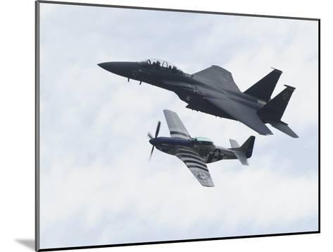 An F-15 Eagle and the P-51 Mustang Fly in Formation-Raul Touzon-Mounted Photographic Print