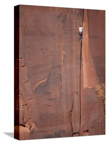A Climber Ascends One of Indian Creeks Many Perfect Hand Cracks-Ben Horton-Stretched Canvas Print