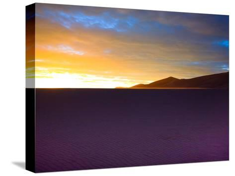 The Sunset Lights Up Sand Blowing across the Colorado Dunes-Ben Horton-Stretched Canvas Print