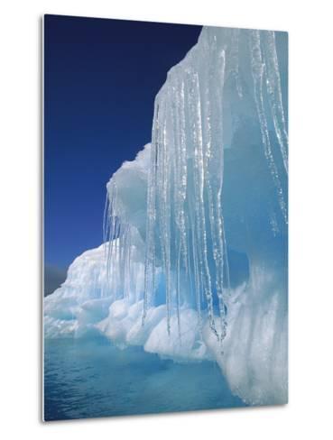 Icicles Hanging from Iceberg, Petermann Island, Antarctic Peninsula, Antarctica-Colin Monteath/Minden Pictures-Metal Print