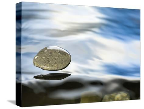 Skipping Stone Just About to Hit the Water's Surface-Michael Durham/Minden Pictures-Stretched Canvas Print