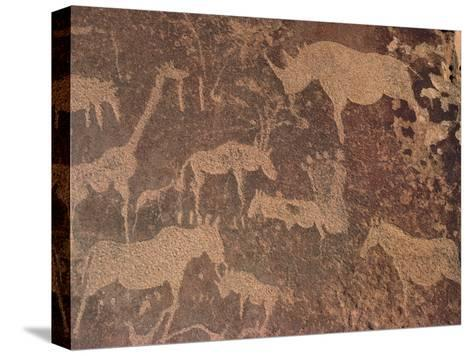 Petroglyphs of Animals Hunted by Bushmen, Twyfelfontein, Namibia-Michael and Patricia Fogden/Minden Pictures-Stretched Canvas Print