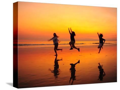 Silhouetted Children Playing on the Beach at Sunset-Jorge Fajl-Stretched Canvas Print