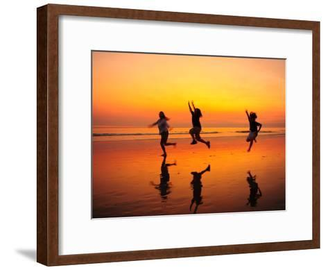 Silhouetted Children Playing on the Beach at Sunset-Jorge Fajl-Framed Art Print