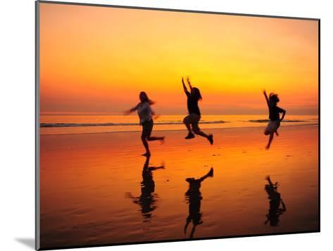 Silhouetted Children Playing on the Beach at Sunset-Jorge Fajl-Mounted Photographic Print