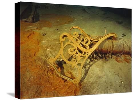 """Metal Deck Bench Frame of the R.M.S. """"Titanic"""" Seen Amid Wreckage on Ocean Floor-Emory Kristof-Stretched Canvas Print"""