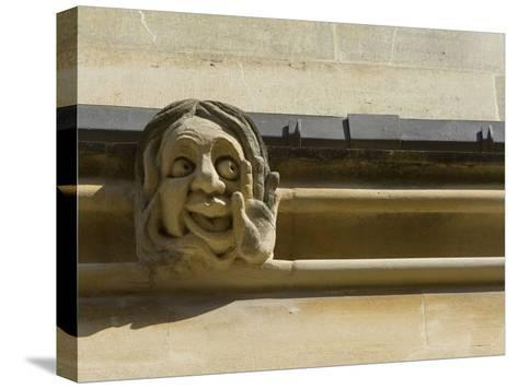 Sandstone Sculpture of a Funny Face, on the Wall of a Building-Joe Petersburger-Stretched Canvas Print