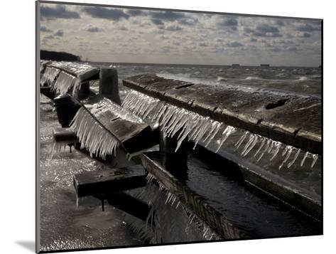 Windblown Icicles Coat a Pier on a Chesapeake Bay Winter Day-Stephen St^ John-Mounted Photographic Print