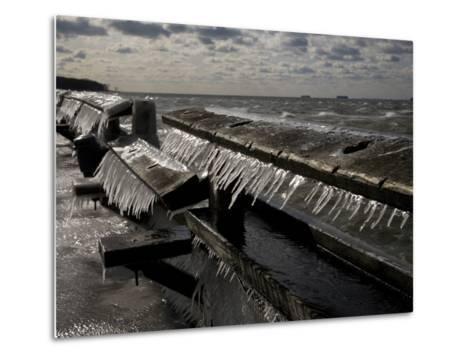 Windblown Icicles Coat a Pier on a Chesapeake Bay Winter Day-Stephen St^ John-Metal Print