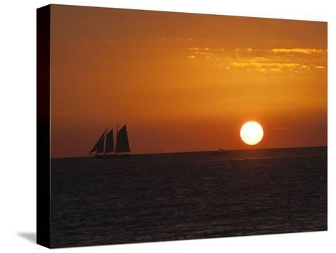 A Boat Sails across the Horizon at Sunset-Karen Kasmauski-Stretched Canvas Print