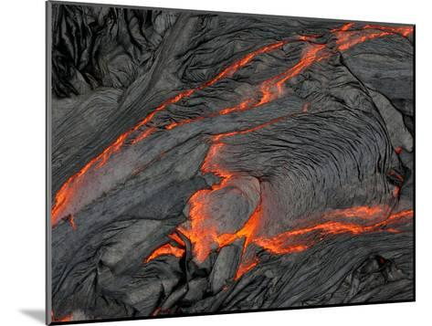Molten Magma Glows under a Dark Crust of Hardened Lava-Patrick McFeeley-Mounted Photographic Print