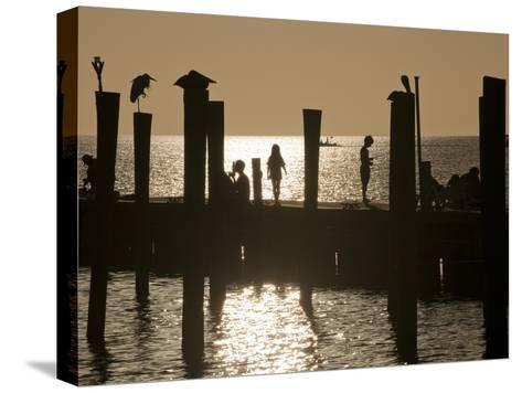 A Backlit View of People on a Pier-Karen Kasmauski-Stretched Canvas Print