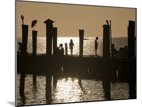 A Backlit View of People on a Pier-Karen Kasmauski-Mounted Photographic Print