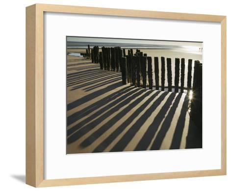 Silhouette of the Remains of a Groyne on the Beach at Dawlish Warren-Nigel Hicks-Framed Art Print