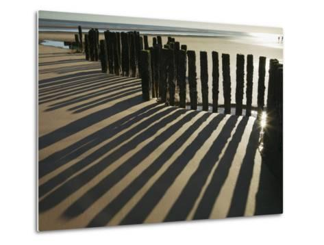 Silhouette of the Remains of a Groyne on the Beach at Dawlish Warren-Nigel Hicks-Metal Print