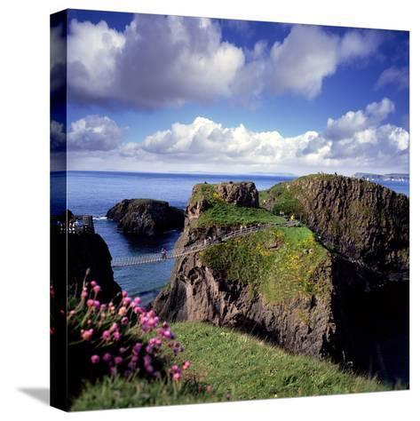 Crossing Carrick-A-Rede Rope Bridge on the North Antrim Coast-Chris Hill-Stretched Canvas Print