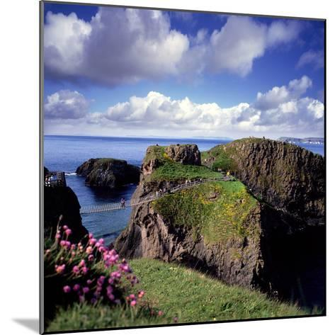 Crossing Carrick-A-Rede Rope Bridge on the North Antrim Coast-Chris Hill-Mounted Photographic Print