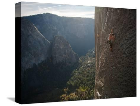 A Climber, Without a Rope, Grips an Expanse of El Capitan-Jimmy Chin-Stretched Canvas Print