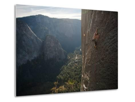 A Climber, Without a Rope, Grips an Expanse of El Capitan-Jimmy Chin-Metal Print
