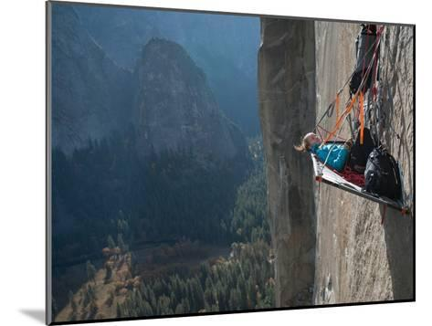 A Climber Reclines on a Hanging Camp on El Capitan-Jimmy Chin-Mounted Photographic Print