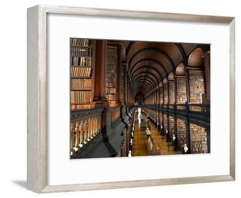 The Long Room in the Old Library at Trinity College in Dublin-Chris Hill-Framed Art Print