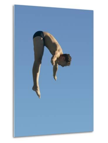 Profile shot of a young man diving--Metal Print