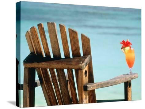 Seychelles, Denis Island, beach chair and fruit cocktail-Sergio Pitamitz-Stretched Canvas Print