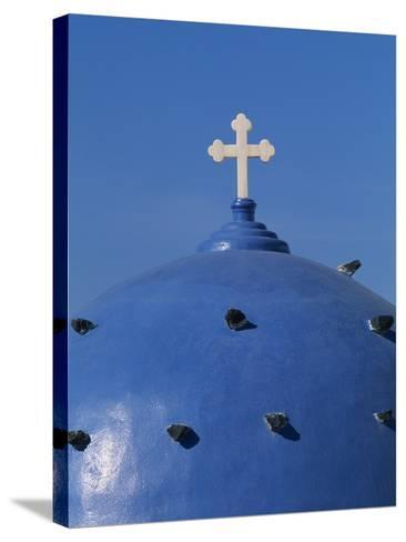 Blue dome of a church with cross on Santorin, Greece-Murat Taner-Stretched Canvas Print