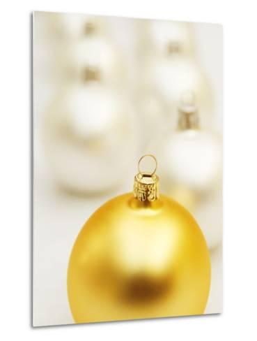 White Christmas tree decorations and a yellow one--Metal Print