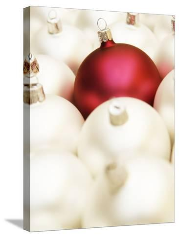 White Christmas tree decorations and a red one--Stretched Canvas Print