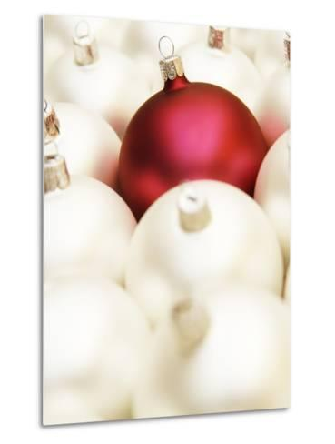 White Christmas tree decorations and a red one--Metal Print