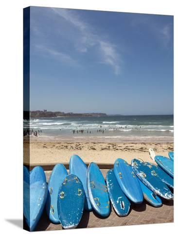 View of stacked up surfboards at the beach--Stretched Canvas Print