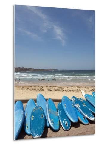 View of stacked up surfboards at the beach--Metal Print