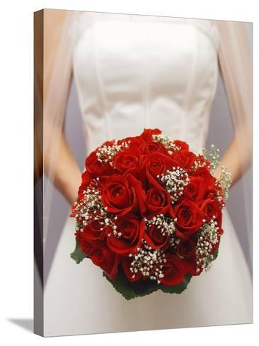 Bride with bridal bouquet--Stretched Canvas Print