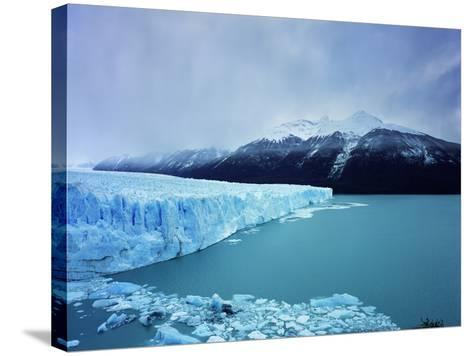 Misty Mountains Behind Glacier-Jonathan Andrew-Stretched Canvas Print