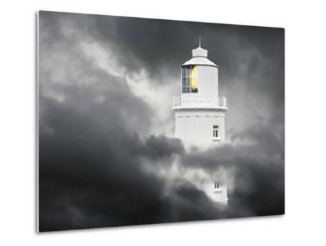 Lighthouse Emerging From Dark Clouds-Paul Hardy-Metal Print
