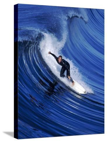 Surfer Riding a Wave-David Pu'u-Stretched Canvas Print