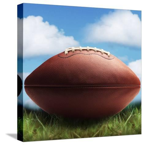 Football in Grass-James Noble-Stretched Canvas Print
