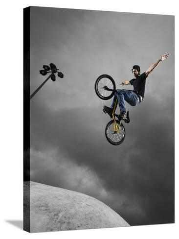 BMX Biker Performing Tricks--Stretched Canvas Print
