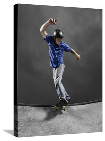 Skateboarder Performing Tricks--Stretched Canvas Print