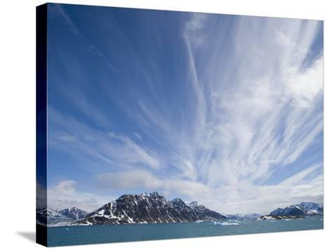 Cirrus Clouds Over Fjord in June-Theo Allofs-Stretched Canvas Print